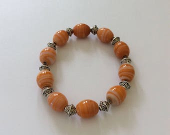 Orange beaded bracelet / beaded bracelet / beaded jewellery /  beach jewellery / orange jewellery