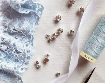 CHANTILLY lace bridal garter in blue sky shade