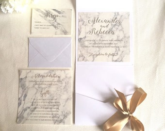 Marble with real gold foil pocket fold wedding invitations. Wedding invitation with marble and real gold foil.