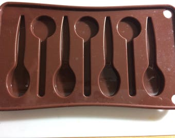 Mold for polymer or kitchen spoons.