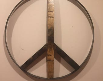 Reclaimed kentucky bourbon barrel peace sign. Made with bourbon barrel ring. Peace sign wall decor.