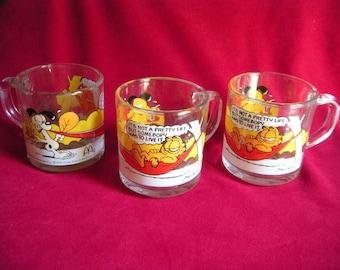 "Three McDonald's GARFIELD Cat ""It's Not A Pretty Life But Somebody..."" Glass Mug - 1978"