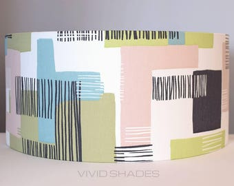 Geometric fabric lampshade handmade by vivid shades, modern abstract shapes and lines stylish cool funky drum ceiling lamp pink green grey