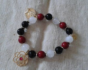 "beautiful bracelet ""trio of beads and charms"""