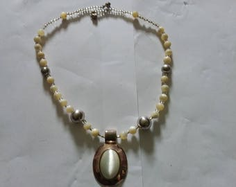 Vintage beaded necklace with a pendant.  Estate found costume jewelry
