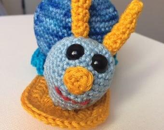 Plush or Amigurumi funny snail head blue crochet blanket.
