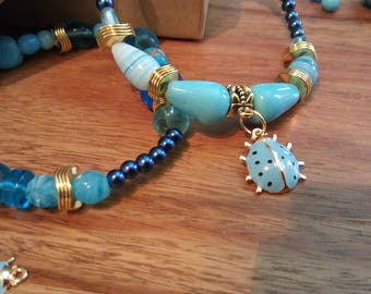 set of two bracelets, glass Pearl, turquoise Ladybug charm