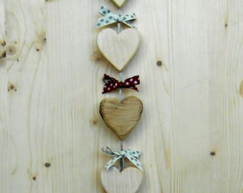 Room small hearts to hang on the wall in various types of wood