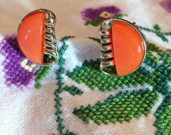 Signed Coro 1960s orange pearlescent clip-on earrings