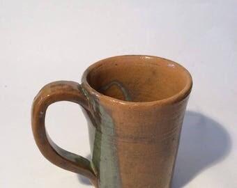 Tall multi colored mug