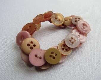 Pale pink upcycled button bracelet