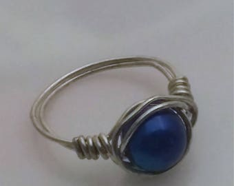 Silver tone wire wrapped ring with vibrant blue stone
