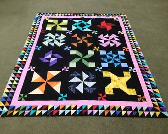 This scrappy quilt top is 12 blocks with black background