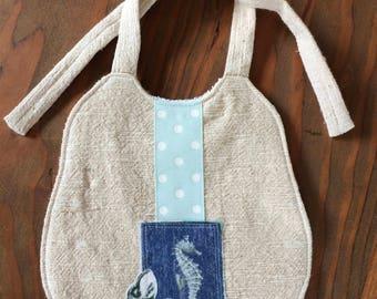 Seahorse accented baby bib, tie bib with PUL lining