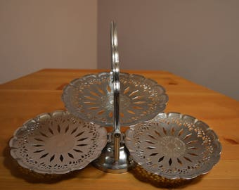 Vintage plated metal folding 3 tier serving tray with nice decorative cut outs and embossed design on round scalloped serving trays