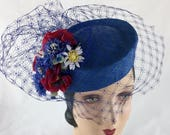 1950s Women's Hat Styles & History 1950s style blue straw pillbox holiday party cocktail hat with vintage silk flowers and veil $175.00 AT vintagedancer.com