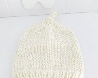 White hat with unisex newborn knot created in knitted with merino wool. Photo props. Handmade. Newborn