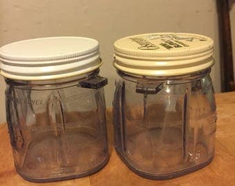 Two Vintage oster blender storage containers