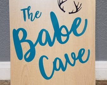 The Babe Cave sign
