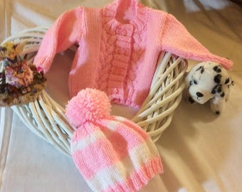child's round neck cardigan and bobble hat