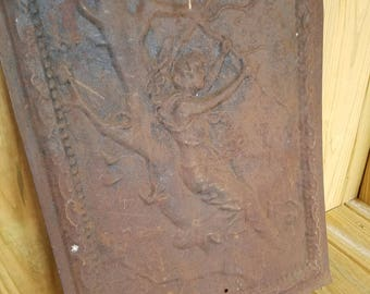 Antique fireplace cover with nice motif