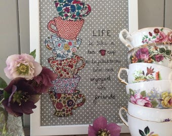 Tea cup quote in frame