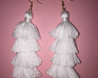 White four tiered tassel earrings