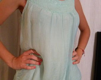 Apple green colored silk sleeveless tunic