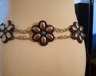 Belt in thick imitation and metal flower motif