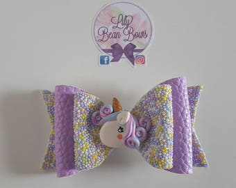 Unicorn sprinkles lilac bow with handmade polymer clay centre