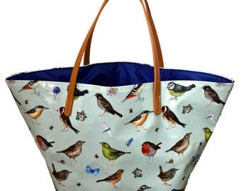 Song Bird Shopping bag fully lined with leather look handles.