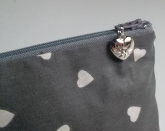 Toiletry bag in coated hearts patterned cotton lined