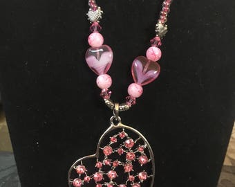 Pink and silver beaded necklace with heart pendant