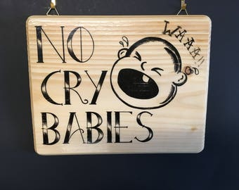 No cry baby tattoo shop sign