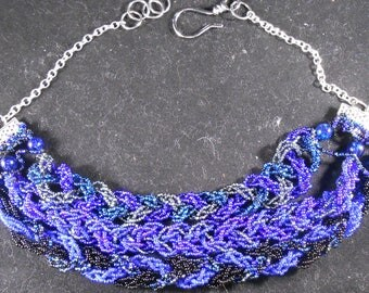 Blues and Black Braided bead necklace.