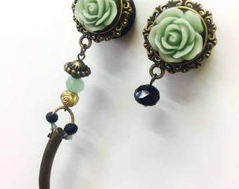 Pending expansions, Earplugs jewerly, unequal earrings, turquoise flower and Horn.