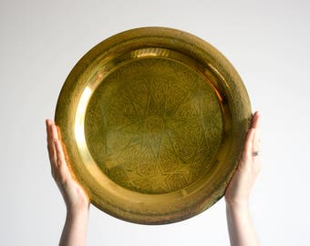 Brass Art Deco platter / serving tray with stamped star pattern