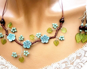 Set of three flowers of turquoise blue pearl and chocolate brown satin