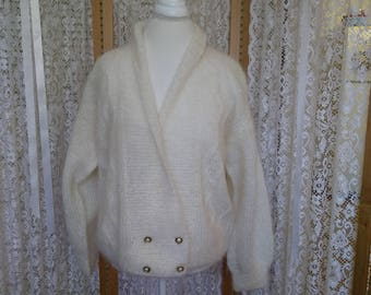Gently used. White lagran mohair cable cardigan with shawl collar. Size M.