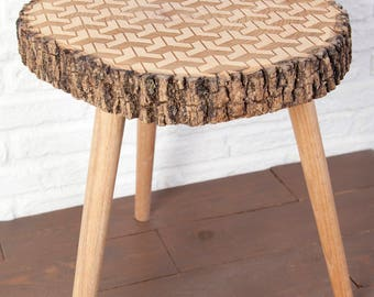 Side table with carved log with geometric pattern