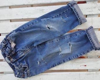 Distressed denim jeans ripped