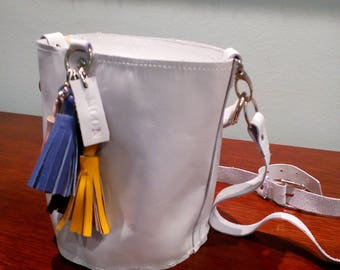 White bag with multicolor tassels