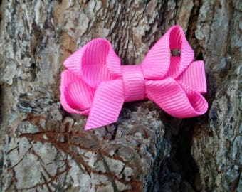 Petite pink twisted boutique bow