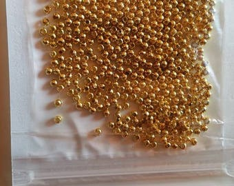 10g of 2 spacer beads 5x2mm gold approximately 590 pcs