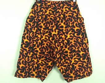 Orange flame print shorts size M