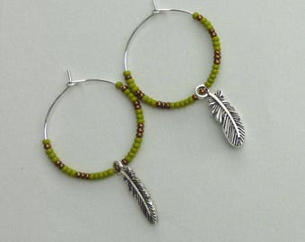 Hoop earrings with seed beads and feather charm