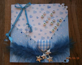 "Birth or christening ""a baby love"" card in blue and white"
