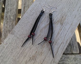 Bicycle inner and plum pearls earrings