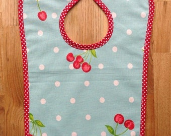 Cherry oilcloth bib and red dots