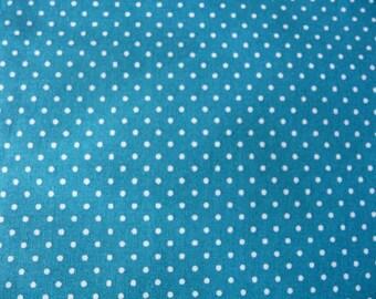 Fabric white polka dots on turquoise background